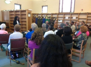 Tsione Wolde-Michael reads in front of a crowd at East Side Freedom Library's Juneteenth event, which celebrates African-American emancipation. About 100 people attended the event, one of three the library has hosted this summer. Source: Twin Cities Daily Planet