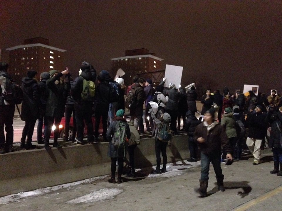 On the center divide on Highway 55 in Minneapolis after grand jury decision to not indict Ferguson police officer, Darren Wilson. Photo: Juan Conatz
